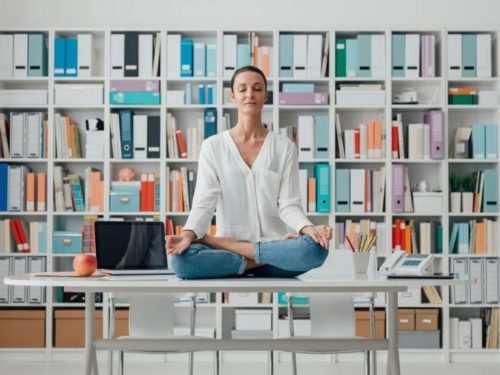 woman practicing meditation on a desk 500x375 - HOME